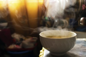 Steaming hot soup in a bowl in the kitchen under warm sunlight. ** Note: Soft Focus at 100%, best at smaller sizes